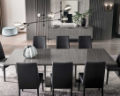 Nova Extending Dining Table - Open with Black Eco Leather Dining Chairs